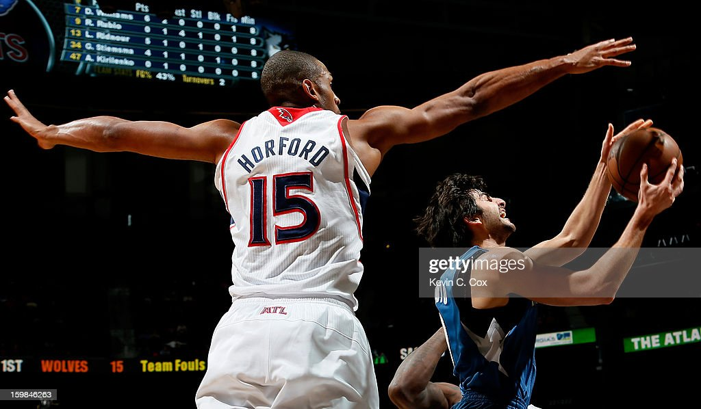 Al Horford #15 of the Atlanta Hawks defends against Ricky Rubio #9 of the Minnesota Timberwolves at Philips Arena on January 21, 2013 in Atlanta, Georgia.