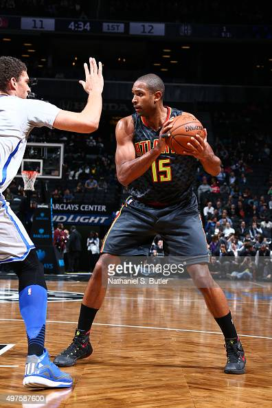 Al Horford of the Atlanta Hawks defends the ball against Brook Lopez of the Brooklyn Nets during the game on NOVEMBER 17 2015 at Barclays Center in...