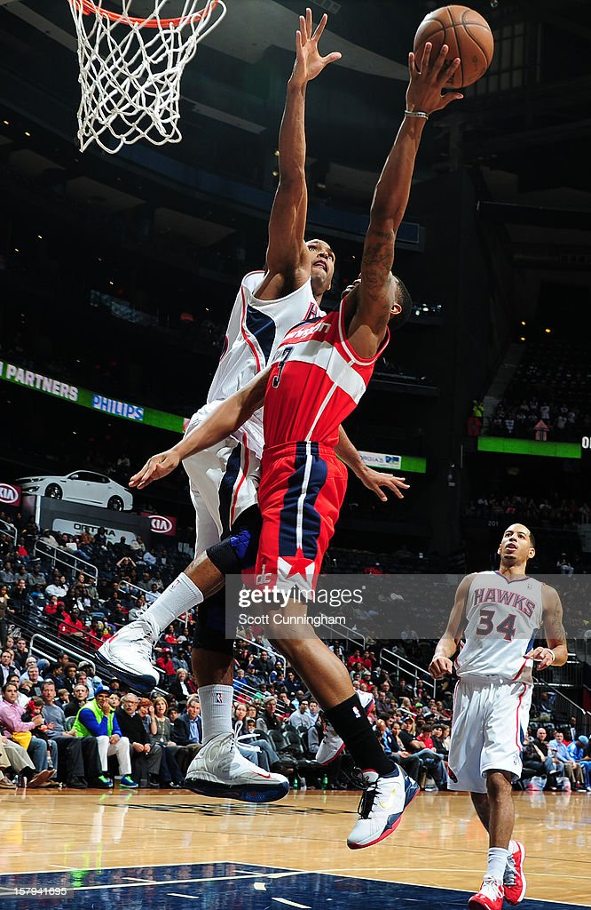 <a gi-track='captionPersonalityLinkClicked' href=/galleries/search?phrase=Al+Horford&family=editorial&specificpeople=699030 ng-click='$event.stopPropagation()'>Al Horford</a> #15 of the Atlanta Hawks defends the basket against the Washington Wizards at Philips Arena on December , 2012 in Atlanta, Georgia.