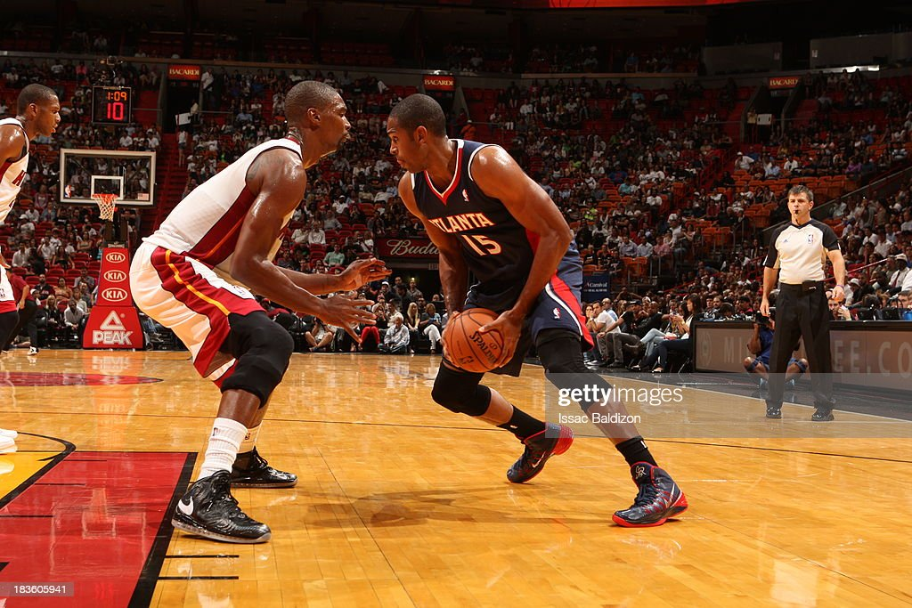 <a gi-track='captionPersonalityLinkClicked' href=/galleries/search?phrase=Al+Horford&family=editorial&specificpeople=699030 ng-click='$event.stopPropagation()'>Al Horford</a> #15 of the Atlanta Hawks dribbles the ball against the Miami Heat during a game on October 7, 2013 at American Airlines Arena in Miami, Florida.