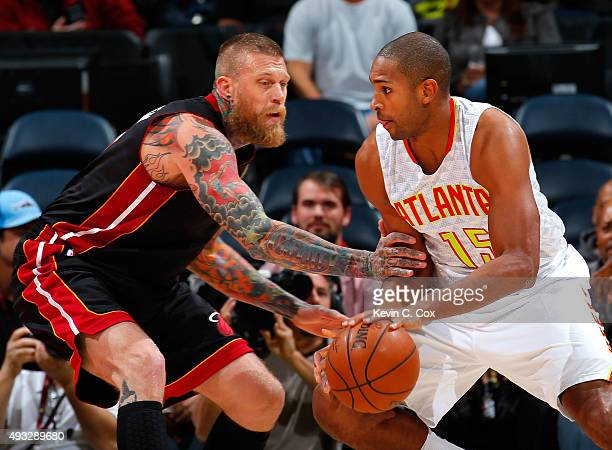Al Horford of the Atlanta Hawks drives against Chris Andersen of the Miami Heat at Philips Arena on October 18 2015 in Atlanta Georgia NOTE TO USER...