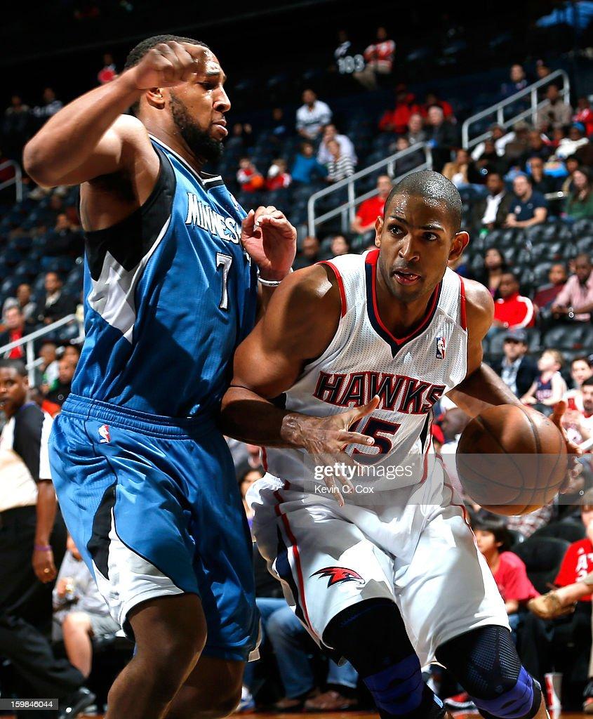 Al Horford #15 of the Atlanta Hawks drives against Derrick Williams #7 of the Minnesota Timberwolves at Philips Arena on January 21, 2013 in Atlanta, Georgia.