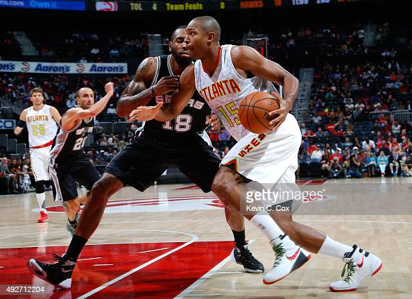 Al Horford of the Atlanta Hawks drives against Rasual Butler of the San Antonio Spurs at Philips Arena on October 14 2015 in Atlanta Georgia NOTE TO...