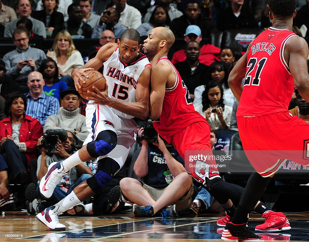 Al Horford #15 of the Atlanta Hawks drives against Taj Gibson #22 of the Chicago Bulls on February 2, 2013 at Philips Arena in Atlanta, Georgia.