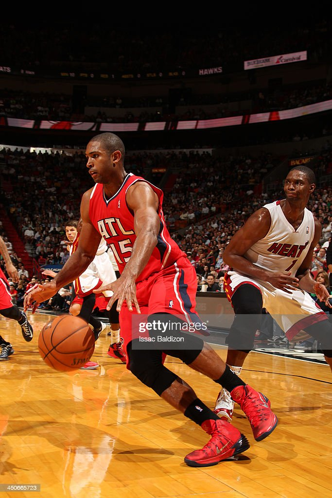 <a gi-track='captionPersonalityLinkClicked' href=/galleries/search?phrase=Al+Horford&family=editorial&specificpeople=699030 ng-click='$event.stopPropagation()'>Al Horford</a> #15 of the Atlanta Hawks drives to the basket against <a gi-track='captionPersonalityLinkClicked' href=/galleries/search?phrase=Chris+Bosh&family=editorial&specificpeople=201574 ng-click='$event.stopPropagation()'>Chris Bosh</a> #1 of the Miami Heat on November 19, 2013 at American Airlines Arena in Miami, Florida.