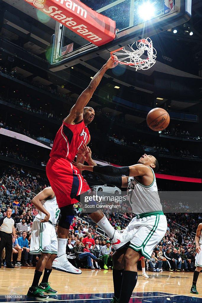 Al Horford #15 of the Atlanta Hawks dunks against Jared Sullinger #7 of the Boston Celtics on January 5, 2013 at Philips Arena in Atlanta, Georgia.