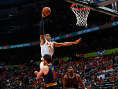 Al Horford of the Atlanta Hawks dunks against Kevin Love of the Cleveland Cavaliers in Game Three of the Eastern Conference Semifinals during the...