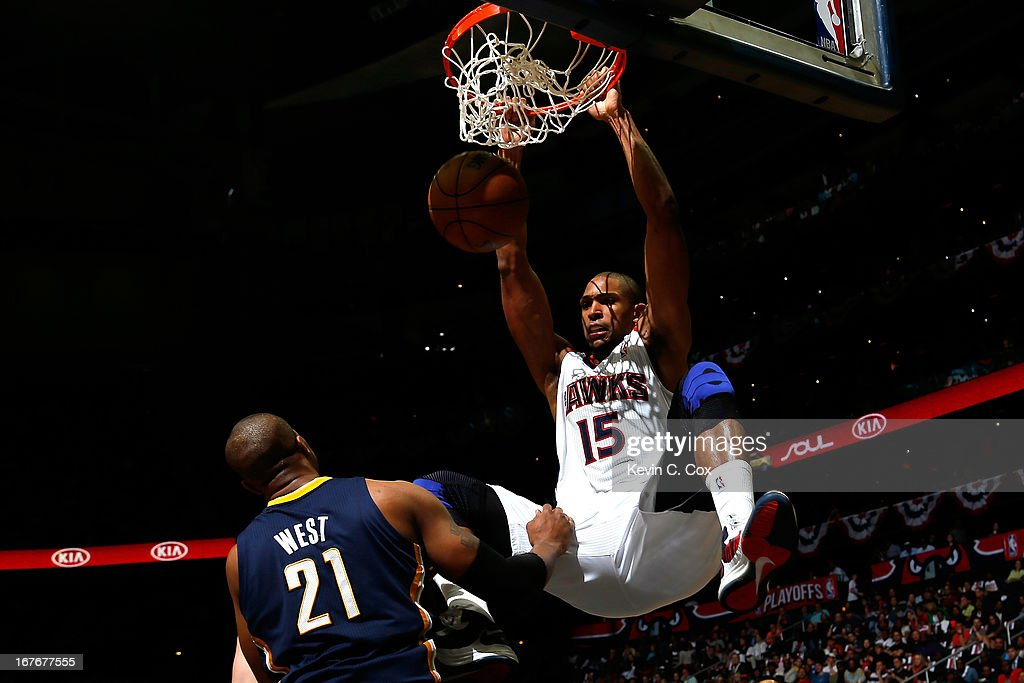 Al Horford #15 of the Atlanta Hawks dunks on David West #21 of the Indiana Pacers during Game Three of the Eastern Conference Quarterfinals of the 2013 NBA Playoffs at Philips Arena on April 27, 2013 in Atlanta, Georgia.