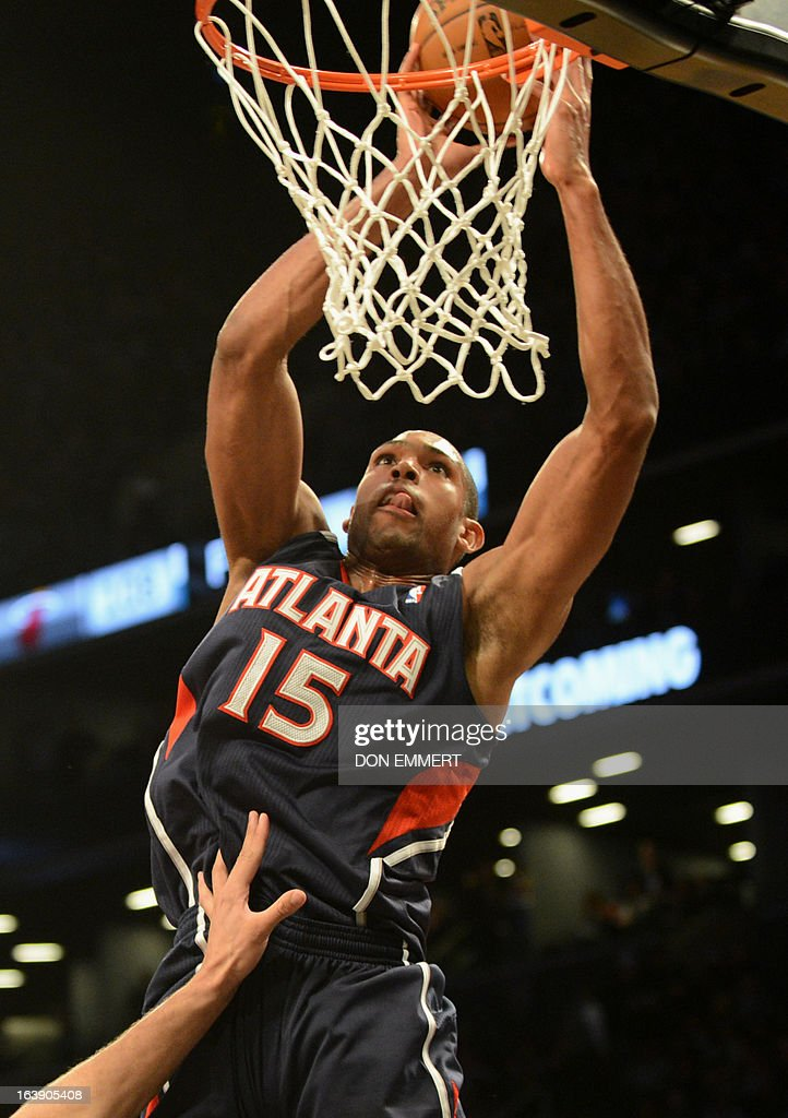 Al Horford of the Atlanta Hawks dunks the ball against Brooklyn Nets March 17, 2013 at the Barclay Center in New York.
