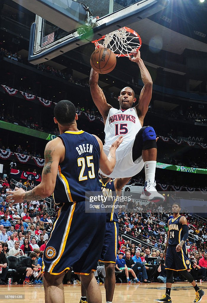 Al Horford #15 of the Atlanta Hawks dunks the ball against Gerald Green #25 of the Indiana Pacers during the Game Three of the Eastern Conference Quarterfinals between the Indiana Pacers and the Atlanta Hawks in the 2013 NBA Playoffs on April 27, 2013 at Philips Arena in Atlanta, Georgia.
