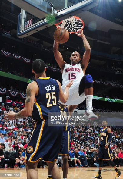 Al Horford of the Atlanta Hawks dunks the ball against Gerald Green of the Indiana Pacers during the Game Three of the Eastern Conference...