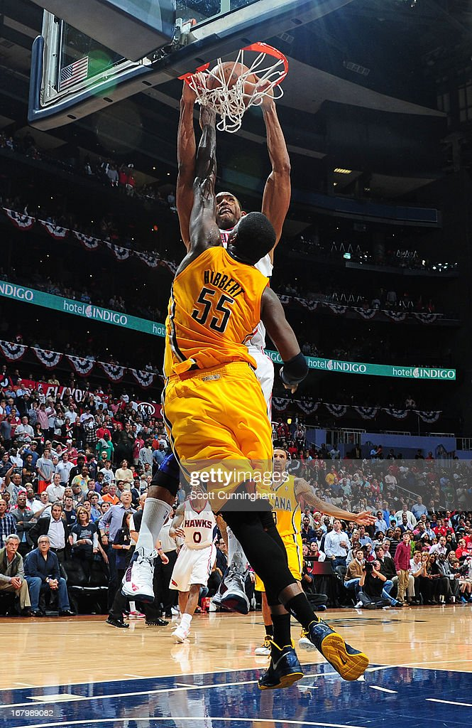 Al Horford #15 of the Atlanta Hawks dunks the ball against the Indiana Pacers during Game Six of the Eastern Conference Quarterfinals in the 2013 NBA Playoffs on May 3, 2013 at Philips Arena in Atlanta, Georgia.