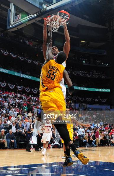 Al Horford of the Atlanta Hawks dunks the ball against the Indiana Pacers during Game Six of the Eastern Conference Quarterfinals in the 2013 NBA...