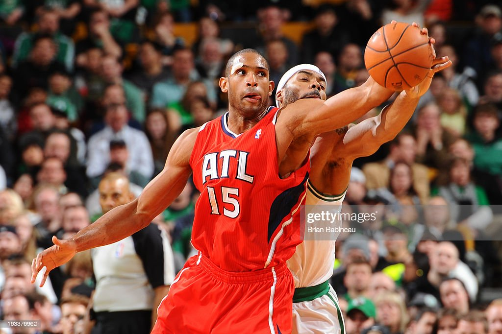 Al Horford #15 of the Atlanta Hawks fights for the ball against Chris Wilcox #44 of the Boston Celtics on March 8, 2013 at the TD Garden in Boston, Massachusetts.