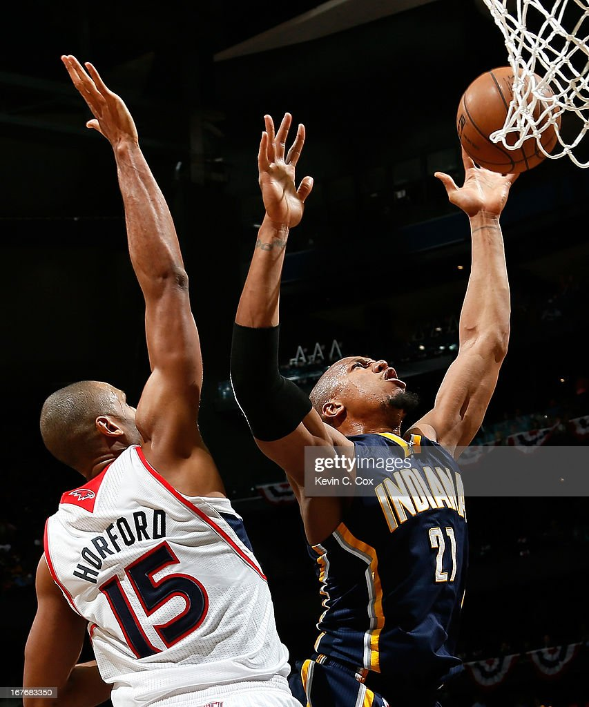 Al Horford #15 of the Atlanta Hawks fouls David West #21 of the Indiana Pacers during Game Three of the Eastern Conference Quarterfinals of the 2013 NBA Playoffs at Philips Arena on April 27, 2013 in Atlanta, Georgia.
