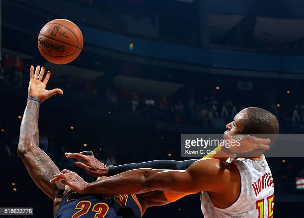 Al Horford of the Atlanta Hawks fouls LeBron James of the Cleveland Cavaliers at Philips Arena on April 1 2016 in Atlanta Georgia NOTE TO USER User...