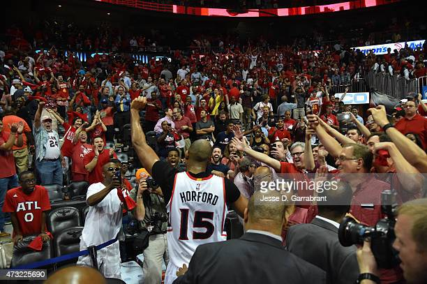 Al Horford of the Atlanta Hawks gives a high five to the fans after hitting the game winning shot against the Washington Wizards in Game five of the...