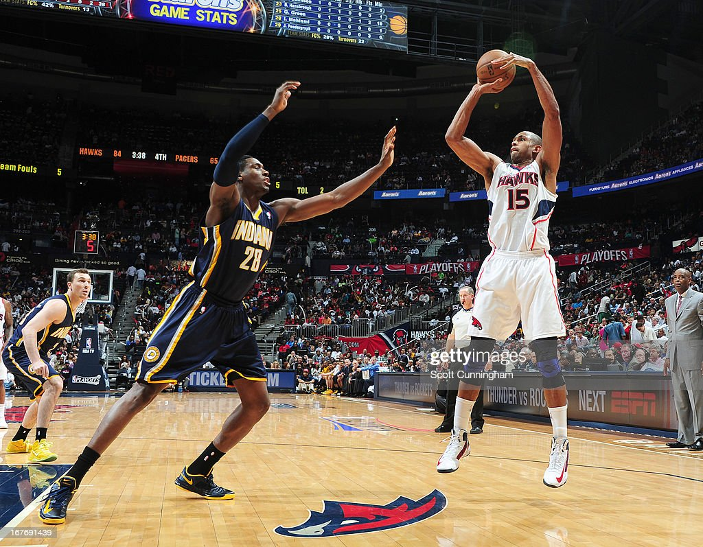 Al Horford #15 of the Atlanta Hawks goes for a jump shot against Ian Mahinmi #28 of the Indiana Pacers during the Game Three of the Eastern Conference Quarterfinals between the Indiana Pacers and the Atlanta Hawks in the 2013 NBA Playoffs on April 27, 2013 at Philips Arena in Atlanta, Georgia.