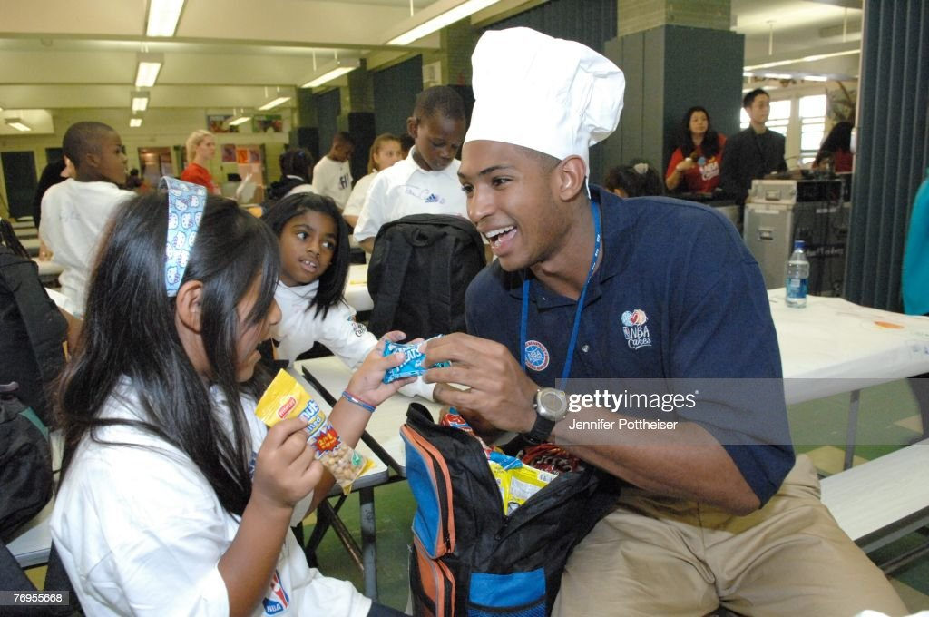 Al Horford of the Atlanta Hawks goes through the lunch bag with treats during the Rookie Transition Program NBA Cares Event at Public School 83 Luis...