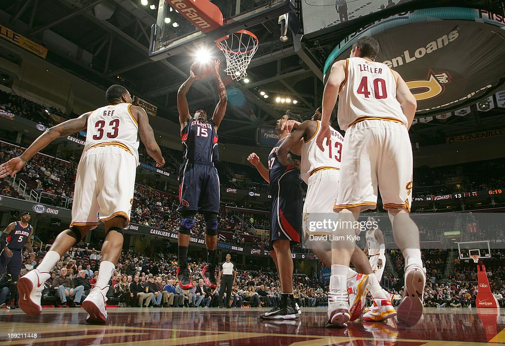 Al Horford #15 of the Atlanta Hawks goes up for the shot against Alonzo Gee #33 and Tristan Thompson #13 of the Cleveland Cavaliers at The Quicken Loans Arena on January 9, 2013 in Cleveland, Ohio.
