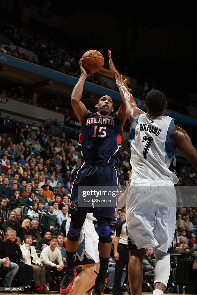 Al Horford #15 of the Atlanta Hawks goes up for the shot against Derrick Williams #7 of the Minnesota Timberwolves during the game on January 8, 2013 at Target Center in Minneapolis, Minnesota.