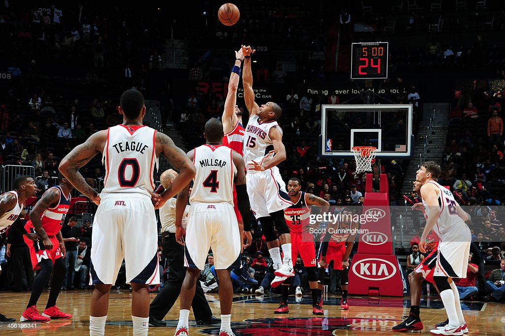 <a gi-track='captionPersonalityLinkClicked' href=/galleries/search?phrase=Al+Horford&family=editorial&specificpeople=699030 ng-click='$event.stopPropagation()'>Al Horford</a> #15 of the Atlanta Hawks goes up for the tip-off against the Washington Wizards on December 13, 2013 at Philips Arena in Atlanta, Georgia.