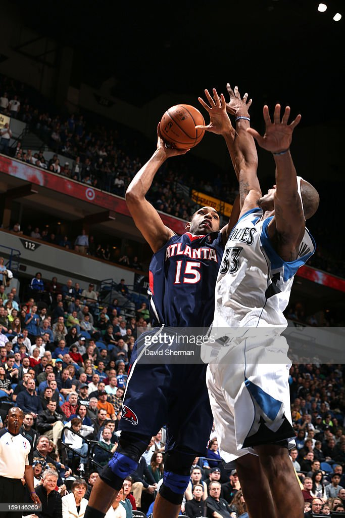 Al Horford #15 of the Atlanta Hawks goes up strong to the basket against Dante Cunningham #33 of the Minnesota Timberwolves during the game on January 8, 2013 at Target Center in Minneapolis, Minnesota.