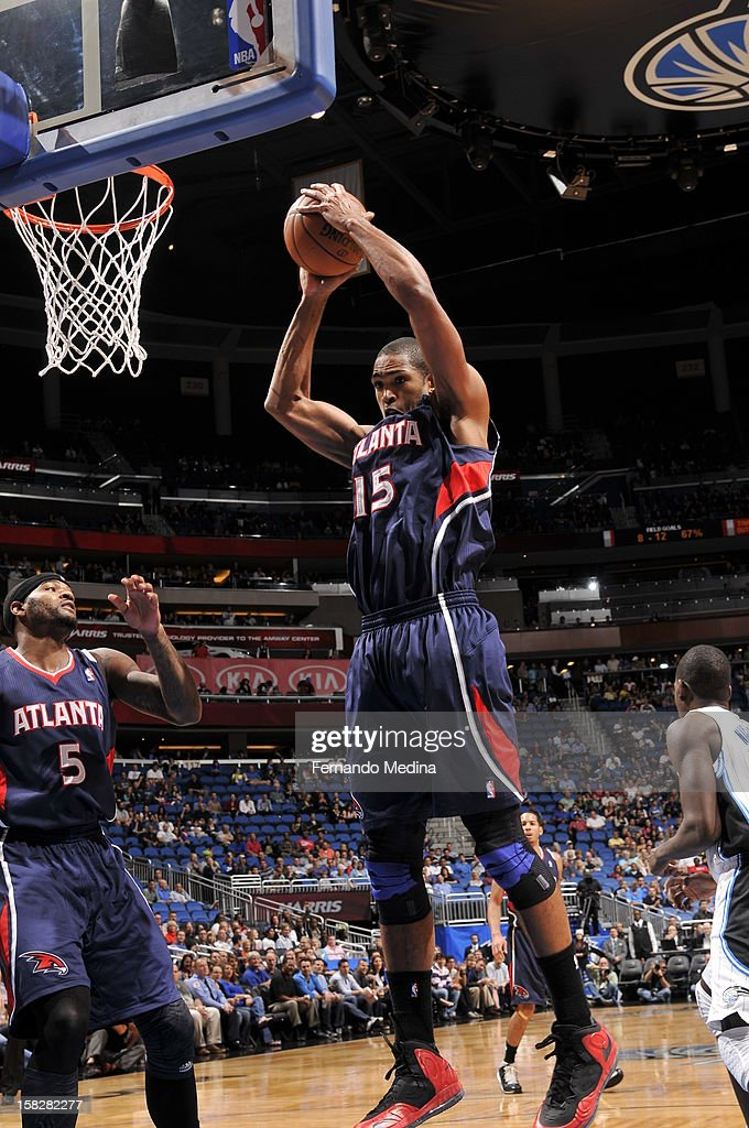 Al Horford #15 of the Atlanta Hawks grabs a rebound against the Orlando Magic during the game on December 12, 2012 at Amway Center in Orlando, Florida.