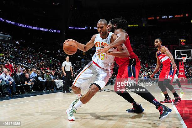 Al Horford of the Atlanta Hawks handles the ball against the Washington Wizards during the game on November 7 2015 at Philips Arena in Atlanta...