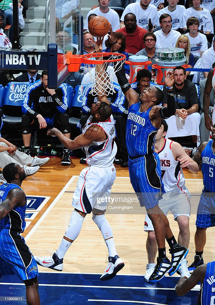 Al Horford #15 of the Atlanta Hawks has his shot attempt blocked by <a gi-track='captionPersonalityLinkClicked' href=/galleries/search?phrase=Dwight+Howard&family=editorial&specificpeople=201570 ng-click='$event.stopPropagation()'>Dwight Howard</a> #12 of the Orlando Magic in Game Three of the Eastern Conference Quarterfinals in the 2011 NBA Playoffs on April 22, 2011 at Philips Arena in Atlanta, Georgia.