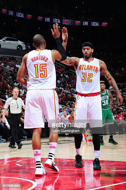 Al Horford of the Atlanta Hawks high fives Mike Scott of the Atlanta Hawks against the Boston Celtics in Game Five of the Eastern Conference...
