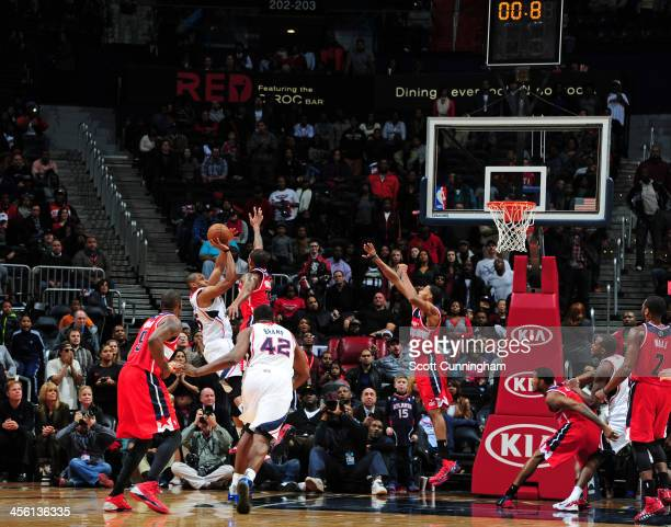 Al Horford of the Atlanta Hawks hits the game winning shot against the Washington Wizards on December 13 2013 at Philips Arena in Atlanta Georgia...