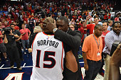 Al Horford of the Atlanta Hawks hugs Dominique Wilkins after hitting the game winning shot against the Washington Wizards in Game five of the Eastern...