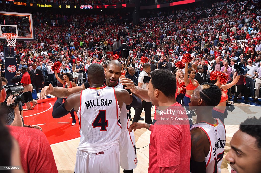 Al Horford of the Atlanta Hawks hugs his teammate after hitting the game winning shot against the Washington Wizards in Game five of the Eastern...
