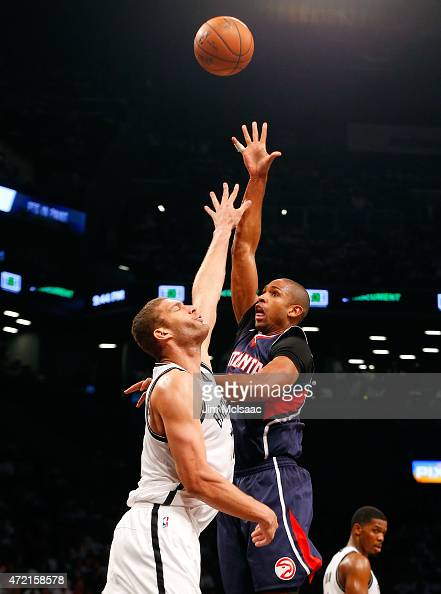 Al Horford of the Atlanta Hawks in action against Brook Lopez of the Brooklyn Nets during game six in the first round of the 2015 NBA Playoffs at...