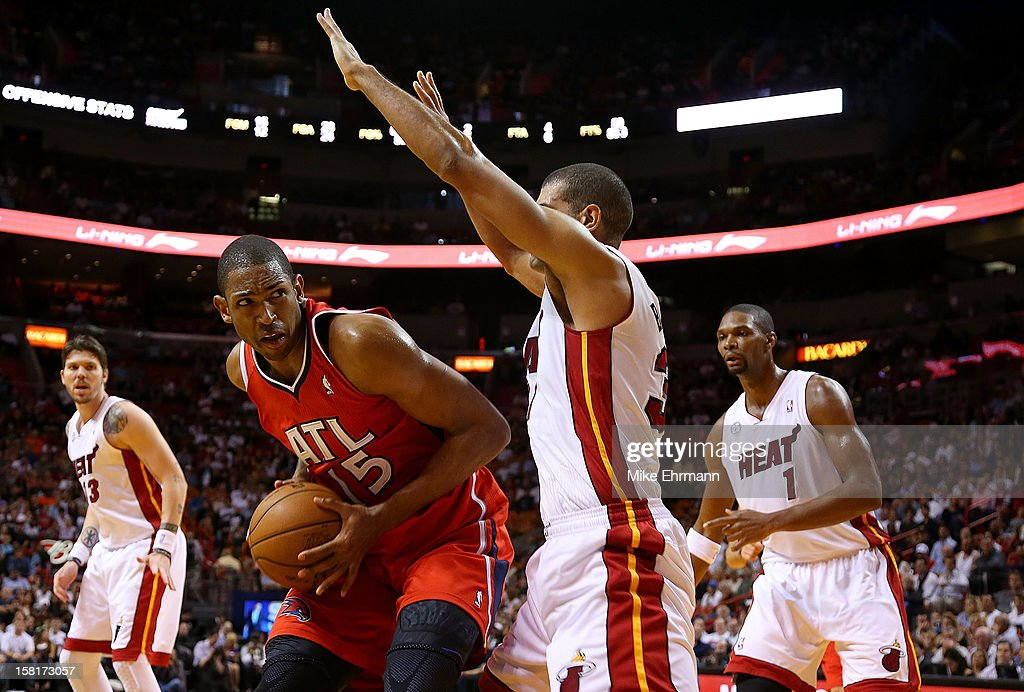 Al Horford #15 of the Atlanta Hawks is guarded by Shane Battier #31 of the Miami Heat during a game at American Airlines Arena on December 10, 2012 in Miami, Florida.