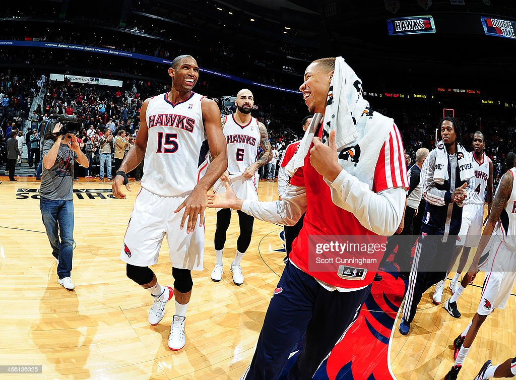<a gi-track='captionPersonalityLinkClicked' href=/galleries/search?phrase=Al+Horford&family=editorial&specificpeople=699030 ng-click='$event.stopPropagation()'>Al Horford</a> #15 of the Atlanta Hawks looks on after he hit the game winning shot against the Washington Wizards on December 13, 2013 at Philips Arena in Atlanta, Georgia.