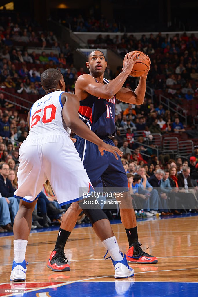 <a gi-track='captionPersonalityLinkClicked' href=/galleries/search?phrase=Al+Horford&family=editorial&specificpeople=699030 ng-click='$event.stopPropagation()'>Al Horford</a> #15 of the Atlanta Hawks looks to pass the ball against <a gi-track='captionPersonalityLinkClicked' href=/galleries/search?phrase=Lavoy+Allen&family=editorial&specificpeople=4628334 ng-click='$event.stopPropagation()'>Lavoy Allen</a> #50 of the Philadelphia 76ers during the game at the Wells Fargo Center on December 21, 2012 in Philadelphia, Pennsylvania.