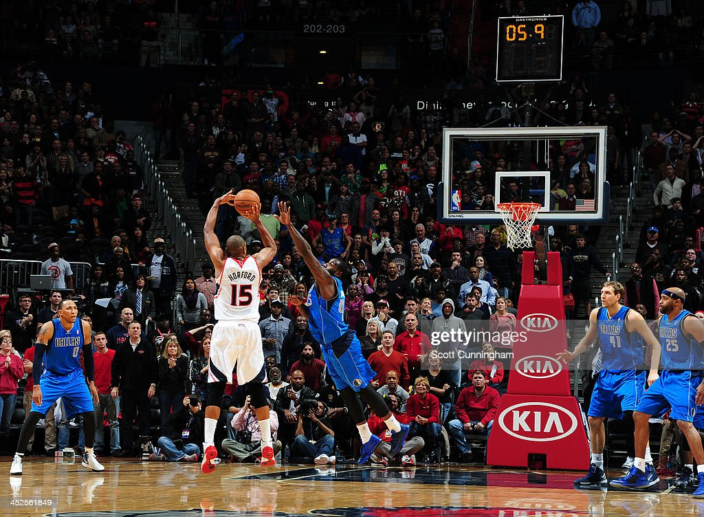 Al Horford #15 of the Atlanta Hawks makes a game winning shot against the Dallas Mavericks on November 29, 2013 at Philips Arena in Atlanta, Georgia.