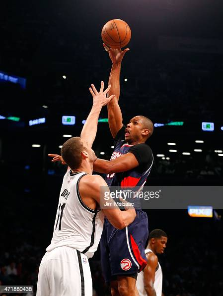 Al Horford of the Atlanta Hawks puts up a shot in the second half against Brook Lopez of the Brooklyn Nets during game six in the first round of the...