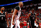 Al Horford of the Atlanta Hawks reacts after scoring a basket against Alan Anderson and Thaddeus Young of the Brooklyn Nets during Game Five of the...