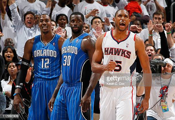 Al Horford of the Atlanta Hawks reacts after their 8884 win over Dwight Howard Brandon Bass and the Orlando Magic during Game Three of the Eastern...