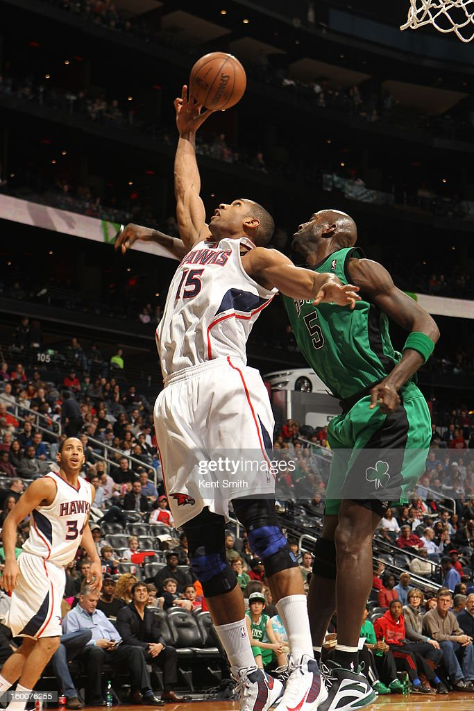 Al Horford #15 of the Atlanta Hawks rebounds against Kevin Garnett #5 of the Boston Celtics at the Philips Arena on January 25, 2013 in Atlanta, Georgia.