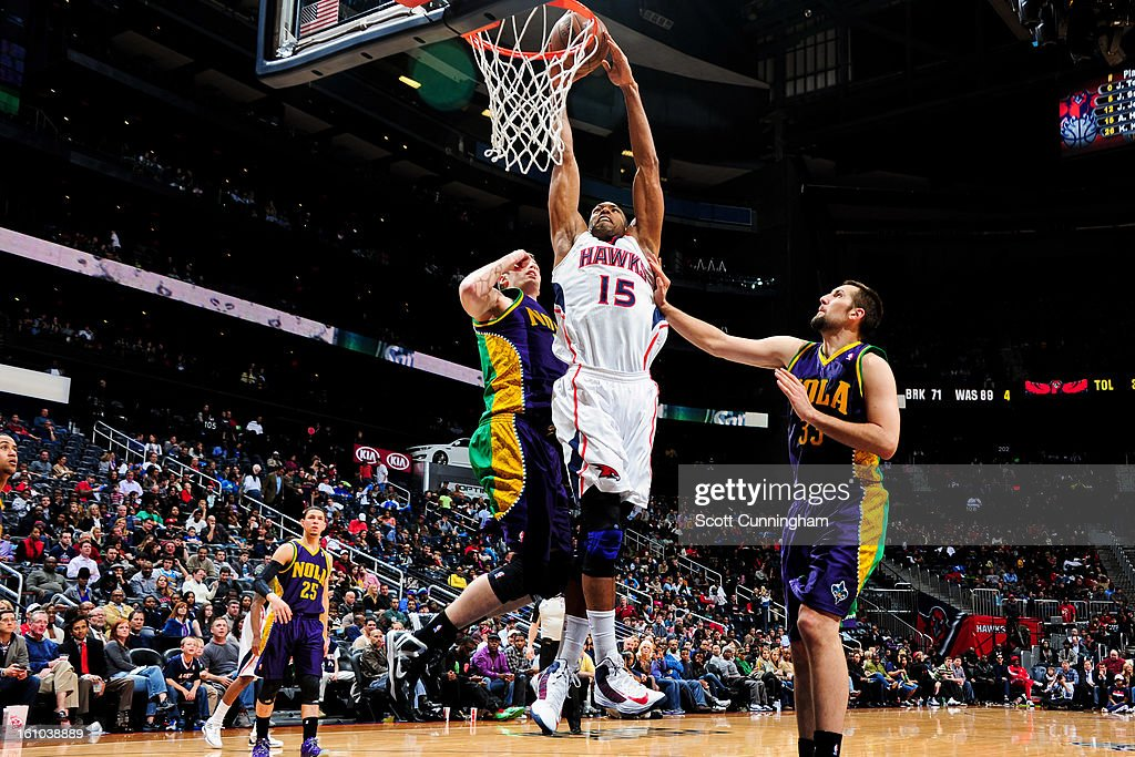 <a gi-track='captionPersonalityLinkClicked' href=/galleries/search?phrase=Al+Horford&family=editorial&specificpeople=699030 ng-click='$event.stopPropagation()'>Al Horford</a> #15 of the Atlanta Hawks rises for a dunk against Ryan Anderson #33 and Jason Smith #14 of the New Orleans Hornets on February 8, 2013 at Philips Arena in Atlanta, Georgia.