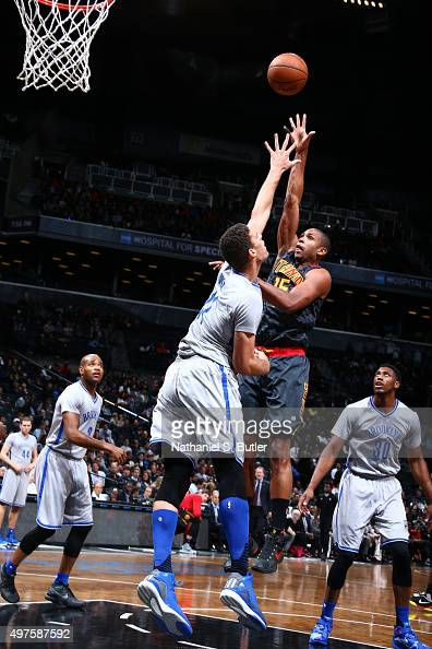 Al Horford of the Atlanta Hawks shoots against Brook Lopez of the Brooklyn Nets during the game on NOVEMBER 17 2015 at Barclays Center in Brooklyn...