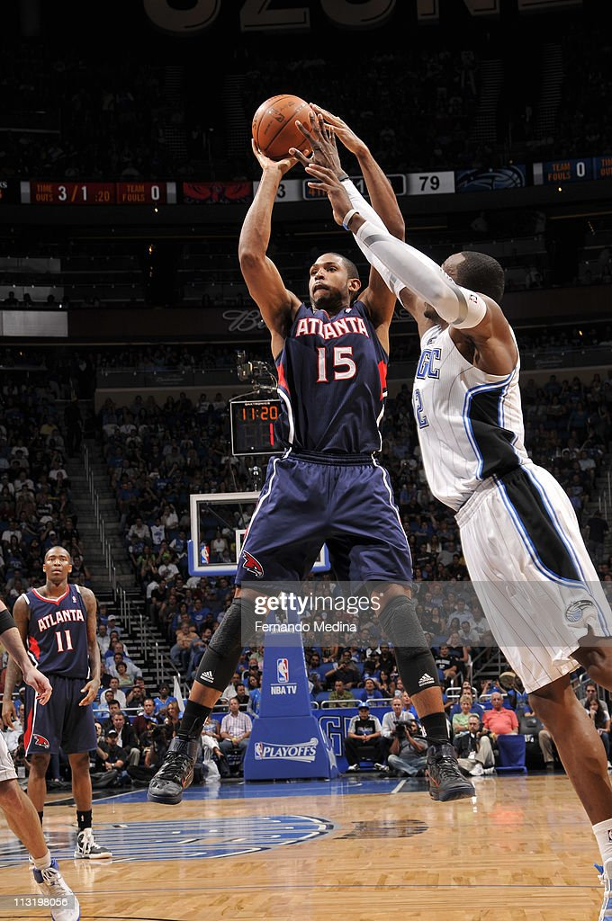 <a gi-track='captionPersonalityLinkClicked' href=/galleries/search?phrase=Al+Horford&family=editorial&specificpeople=699030 ng-click='$event.stopPropagation()'>Al Horford</a> #15 of the Atlanta Hawks shoots against <a gi-track='captionPersonalityLinkClicked' href=/galleries/search?phrase=Dwight+Howard&family=editorial&specificpeople=201570 ng-click='$event.stopPropagation()'>Dwight Howard</a> #12 of the Orlando Magic in Game Five of the Eastern Conference Quarterfinals in the 2011 NBA Playoffs on April 26, 2011 at the Amway Center in Orlando, Florida.