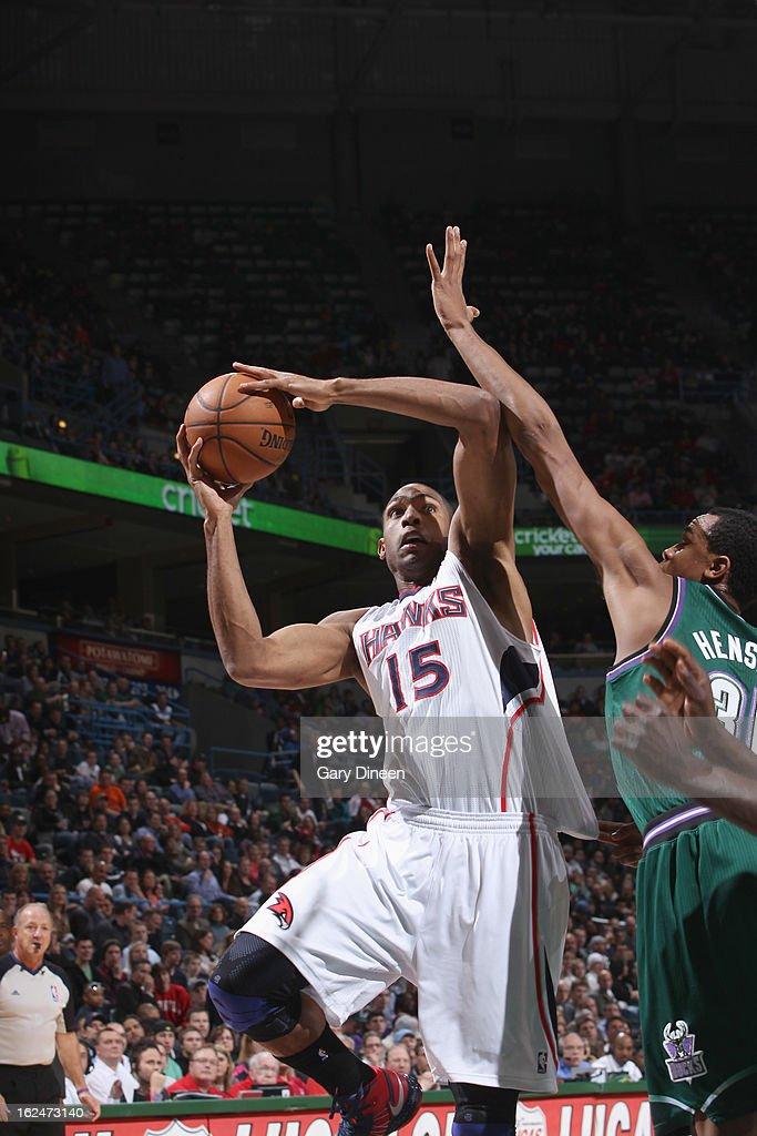 Al Horford #15 of the Atlanta Hawks shoots against John Henson #31 of the Milwaukee Bucks on February 23, 2013 at the BMO Harris Bradley Center in Milwaukee, Wisconsin.