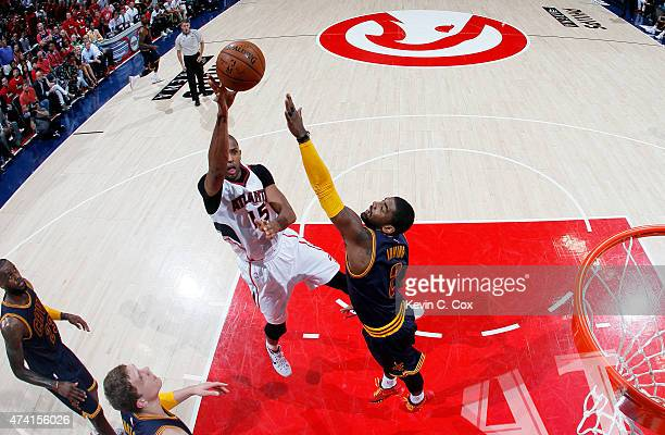 Al Horford of the Atlanta Hawks shoots against Kyrie Irving of the Cleveland Cavaliers in the first half during Game One of the Eastern Conference...