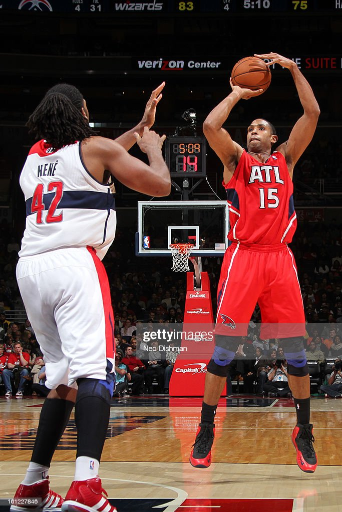 Al Horford #15 of the Atlanta Hawks shoots against Nenê #42 of the Washington Wizards during the game at the Verizon Center on January 12, 2013 in Washington, DC.