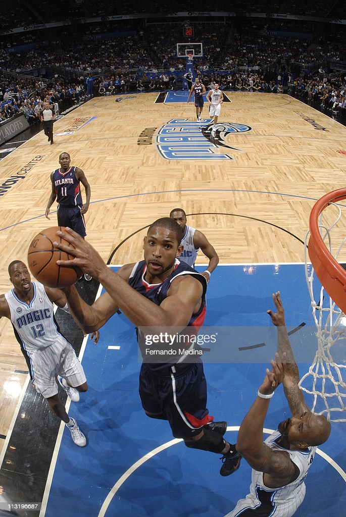 <a gi-track='captionPersonalityLinkClicked' href=/galleries/search?phrase=Al+Horford&family=editorial&specificpeople=699030 ng-click='$event.stopPropagation()'>Al Horford</a> #15 of the Atlanta Hawks shoots against <a gi-track='captionPersonalityLinkClicked' href=/galleries/search?phrase=Quentin+Richardson&family=editorial&specificpeople=201714 ng-click='$event.stopPropagation()'>Quentin Richardson</a> #5 of the Orlando Magic in Game Five of the Eastern Conference Quarterfinals in the 2011 NBA Playoffs on April 26, 2011 at the Amway Center in Orlando, Florida.